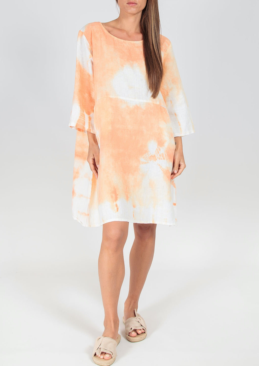 "We Can Do This Dress - Orange, by Ridley  This modern take on a classic linen style, features a unique tie dye effect in fresh orange and white.   Wear with slides or white sneakers, or in cooler months with tan boots.  Features:  Relaxed fit  Scoop neck  3/4 sleeves  Button up at back of neck  100% linen  Made in Italy  Model is 5""5' and wears a size S"