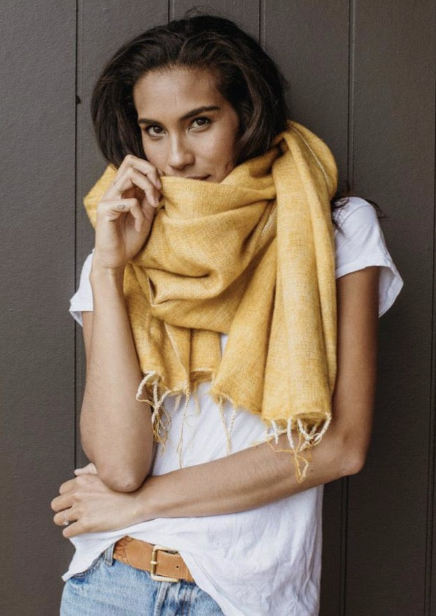 Our shawl/wrap/scarf has multi uses.  Style up or style down, its perfect for early morning yoga sessions and beach sun downers.  The ideal travel companion that can be accessorised with your trashed denim or cocktail dress.  Hand woven in Nepal on majestic wooden looms using a soft, unique yarn and finished with perfectly twisted tassels.  Approx size overall 76cm x 188cm.