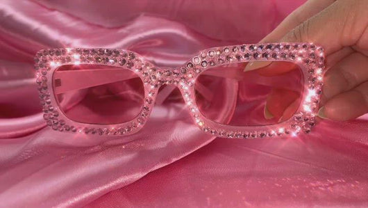 video of pink sunglasses with pink crystals on them