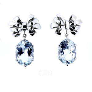 The Celine Ribbon Bow Earrings with Beryl Enhancers