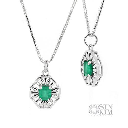 Custom made green step cut Emerald set in 14k white gold octagonal pendant with flower motifs, on 20 inch wheat chain.