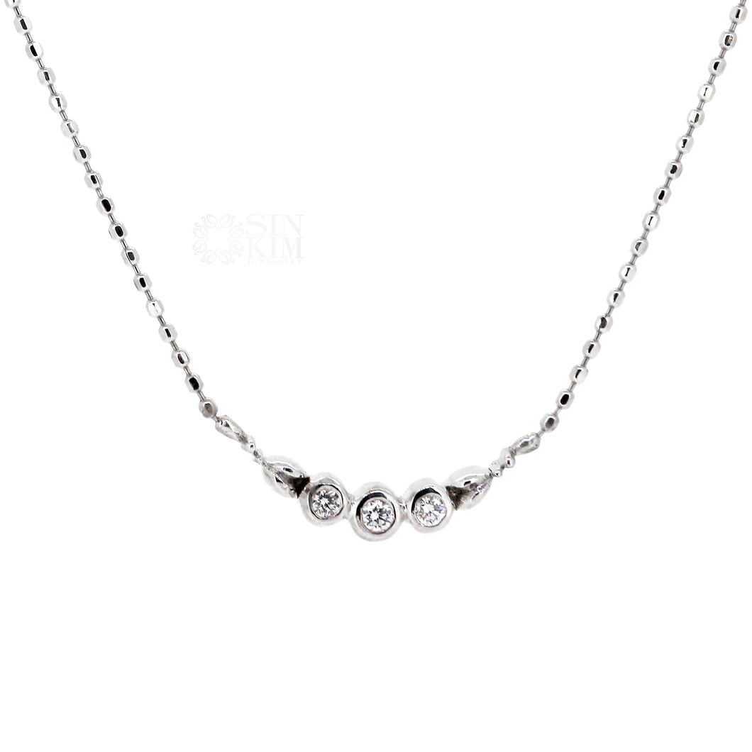 Dainty diamond trinity necklace with floral motif on 18k, 18