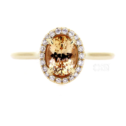 Halo ring with lovely, ethically sourced Apricot colour, 1.28ct Oval Sapphire, from Sri Lanka.  Made in Toronto, Canada