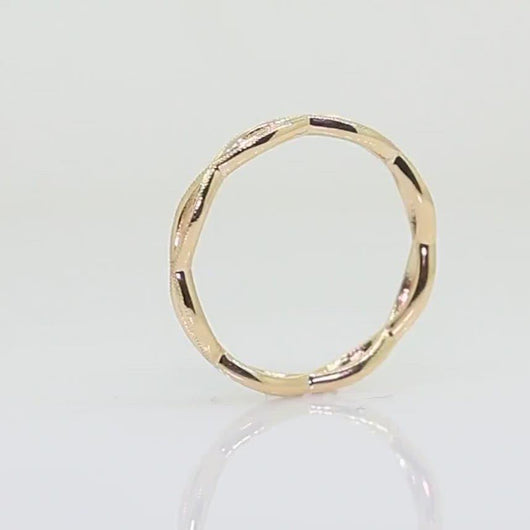 14k yellow gold open wave band with millgrain video of ring spinning