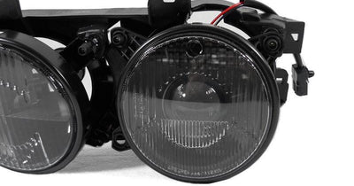 "1989-1996 BMW E34 5 Series / E32 7 Series DEPO Euro Smiley Cross Hair GLASS Lens Projector Headlight-Lighting-DEPO- Description Fitment • 1989-1996 BMW E34 5 Series • 1988-1995 BMW E32 7 Series Features • OEM Style Euro Spec with Glass lens and Projector, Lens with 5 3/4"" diameter, with additional city light (Bulb size T10 W5W) in the high beam housing feature. • Special Cross Hair Edition with clear lens and black housing that appears to be smoked. • E-code Projector Lens using H1/H1 Size of bu"