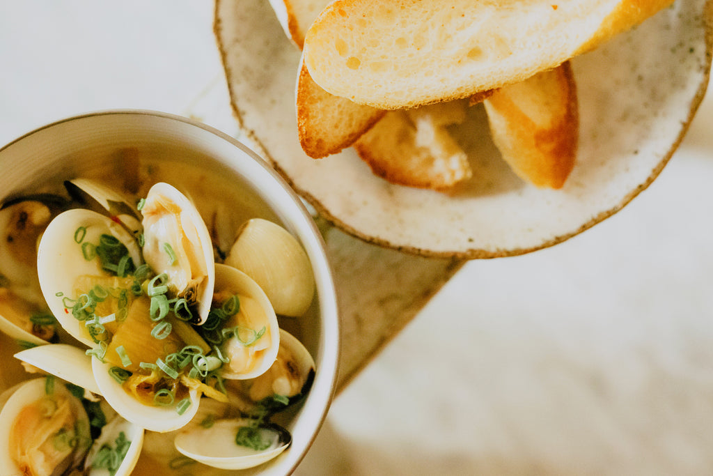 Steamed Venus Clams | dried fig chicken broth, homemade kimchi, pickled wakame