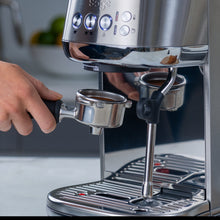 Load image into Gallery viewer, using the Sage the Bambino Plus coffee machine
