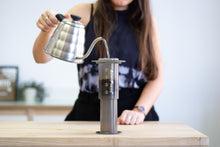 Load image into Gallery viewer, Water being poured into an Aeropress Coffee Maker using a gooseneck kettle