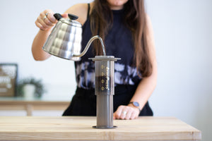 Water being poured into an Aeropress Coffee Maker using a gooseneck kettle