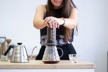 Load image into Gallery viewer, Coffee being plunged into a coffee jug from an AeroPress coffee maker