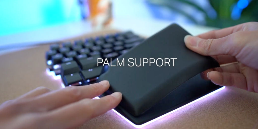 Gaming keyboard with palm support
