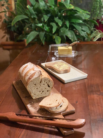 Bread on board with butter