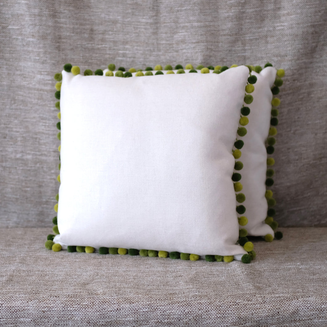 Pair of Green Pom Pom Pillows