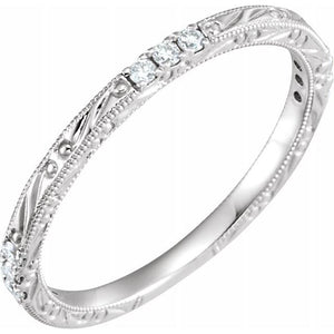 Filigree-spaced diamond ring