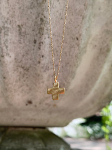 Hammered gold cross