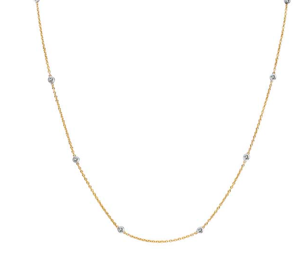 Two tone diamond station necklace