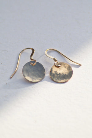 Gold Dangle Earrings on a white background