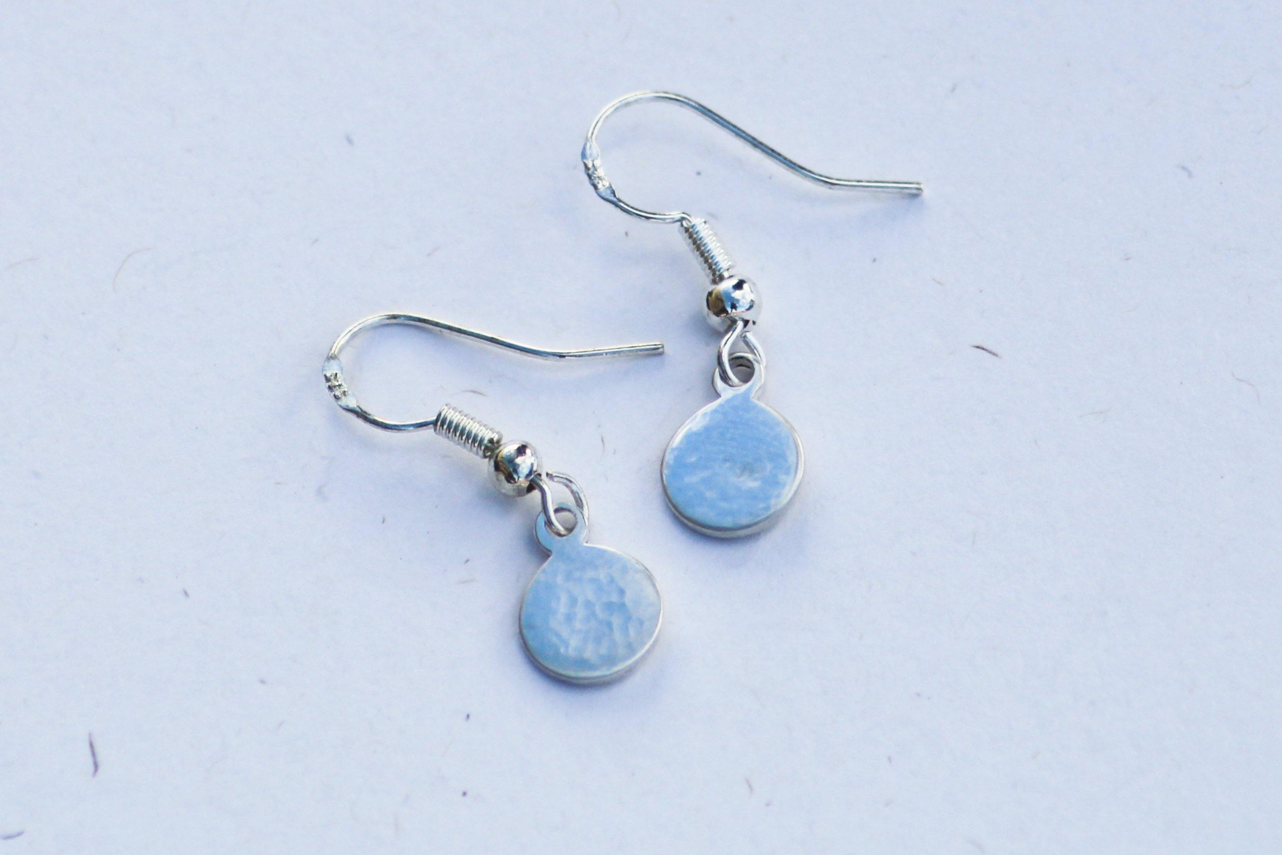 Sterling Silver Dangle Earrings on a white surface