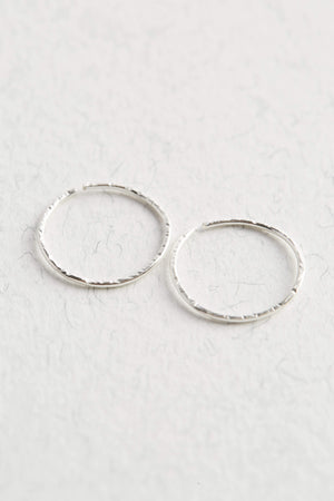 A pair of Sterling Silver Hoop Earrings on a white background.