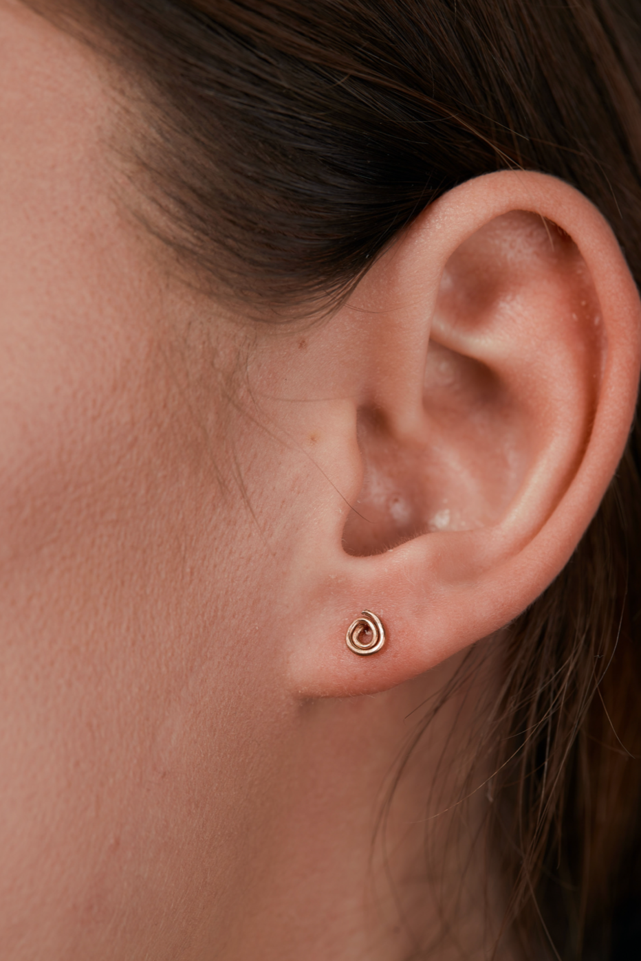 Copper Stud Earrings in womans ear