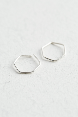 Sterling Silver Hexagon Hoop Earrings on a white surface