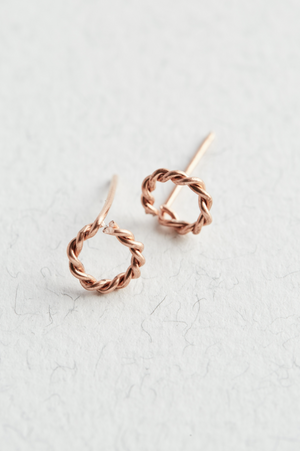 Copper Twisted Stud Earrings on a white surface