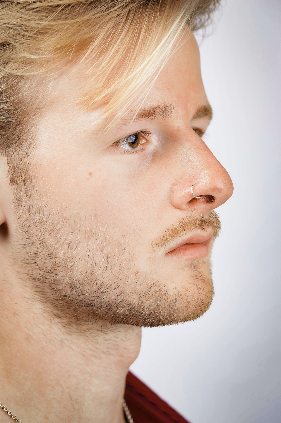 close up of a man wearing a Sterling Silver Nose Ring