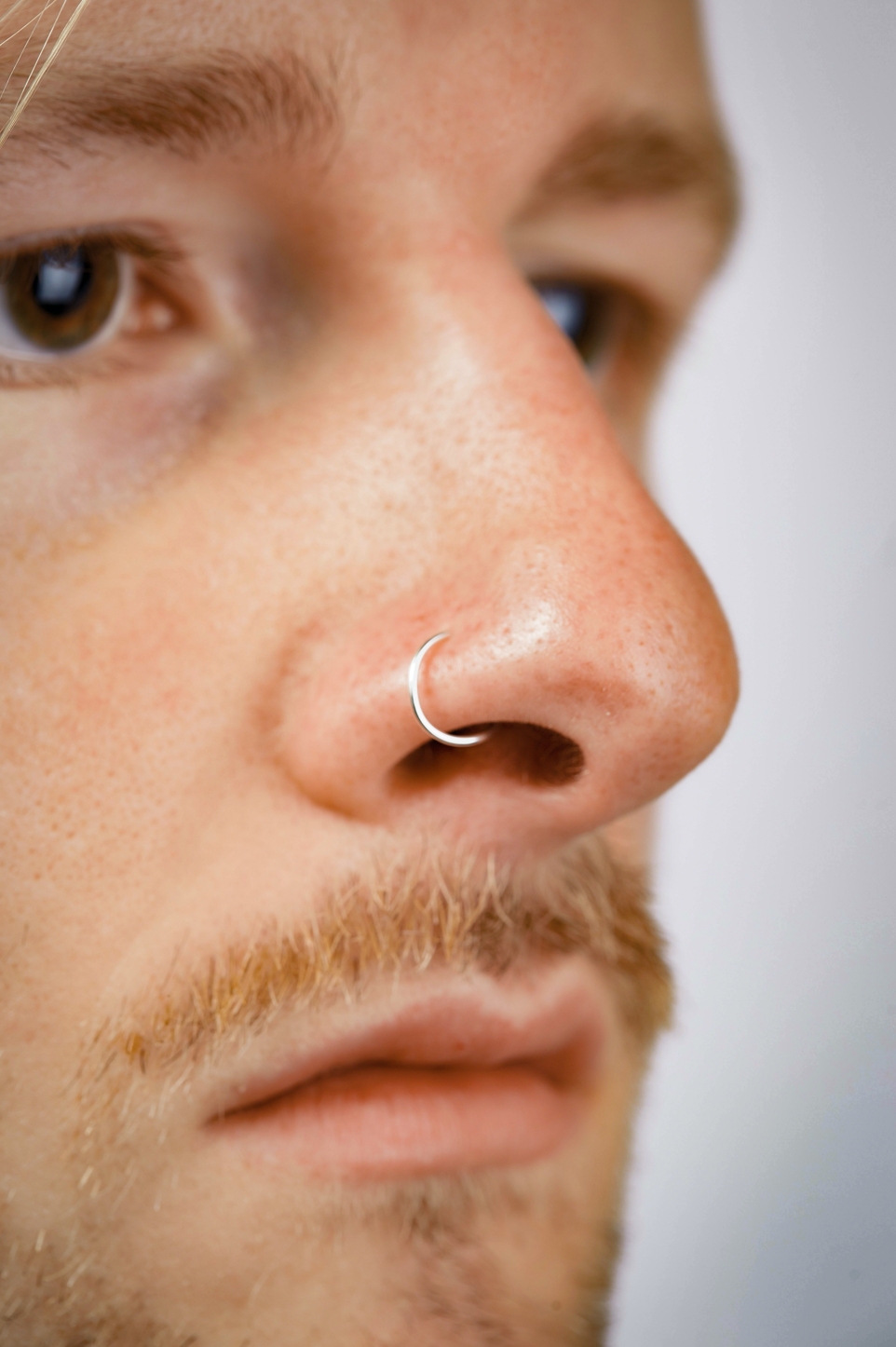 close up of a man wearing a Silver Nose Ring