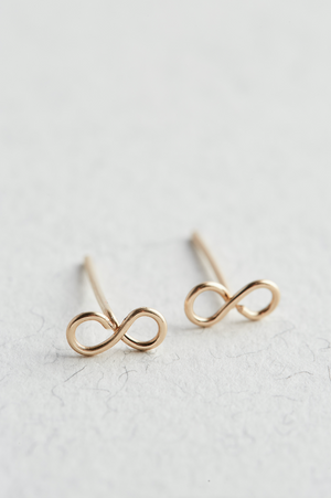 14k Gold Infinity Stud Earrings on a white surface