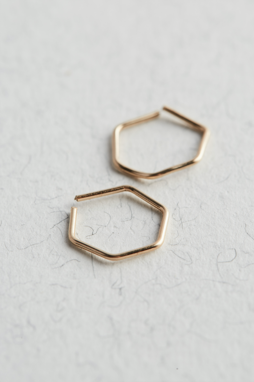 14k Gold Hexagon Hoop Earrings on a white background