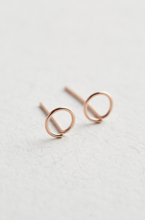 Rose Gold Circle Stud Earrings on a white background