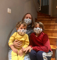 Amy and her children with the first masks for MasksForAll