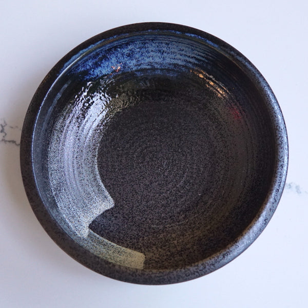 Dark deep round bowl