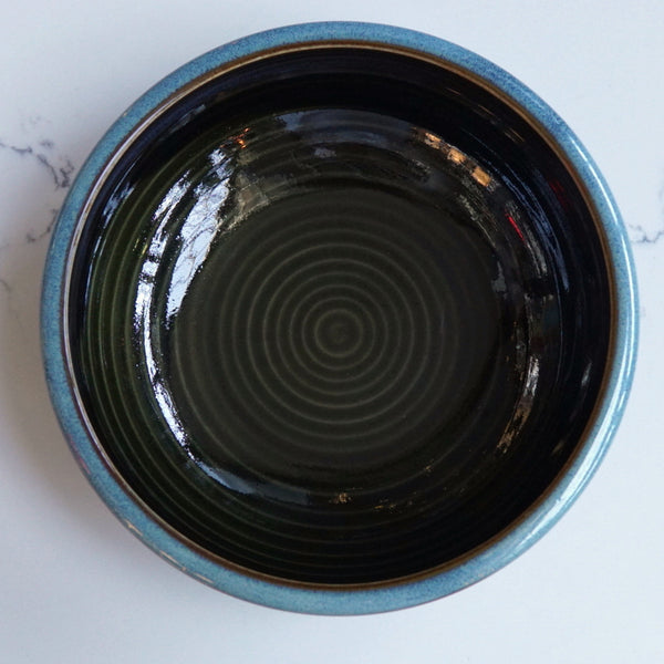 Dark deep round bowl with teal edge