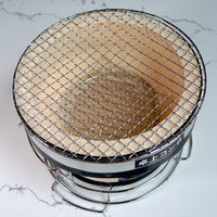 Round hibachi charcoal grill