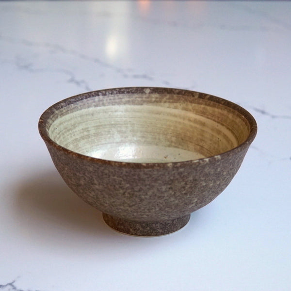 Small brown stone bowl