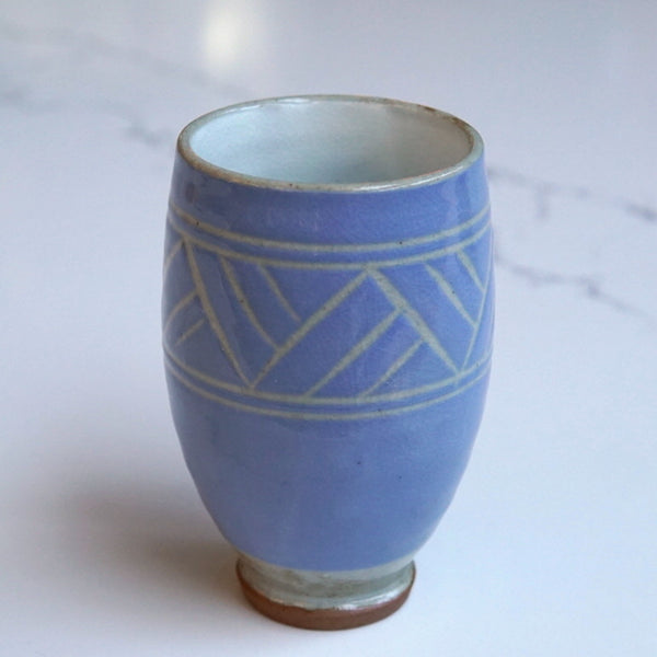 Tall light blue tea cup