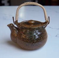 Green and brown speckled teapot