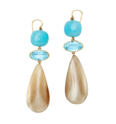 polished horn earring topped with blue topaz