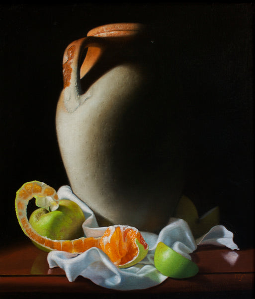 Vase with white cloth, orange and apple