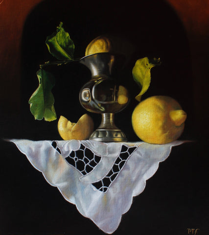 Lemons with pewter vase and white lace cloth