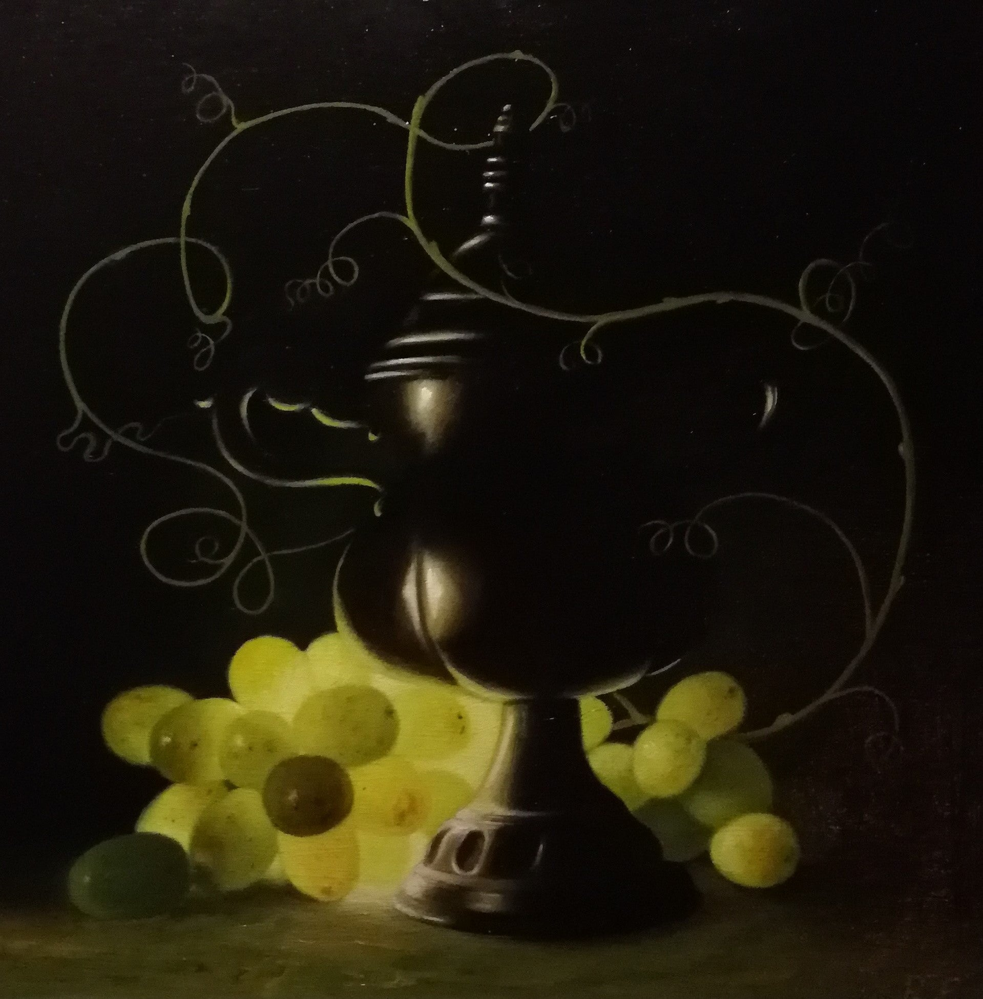 Yellow grapes and dark vase