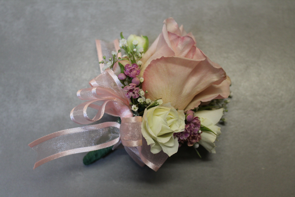 Romantic pastel corsage for mother of the bride and groom