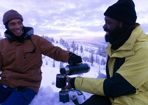 Elijah pours Kenny a Hot Toddy from his Stanley vacuum bottle after a long day of snowboarding at Timberline Resort.