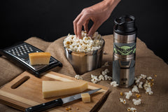 The Popcorn + The Child Trigger-Action Mug