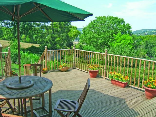 A delightful decking area overlooking a wooded glade