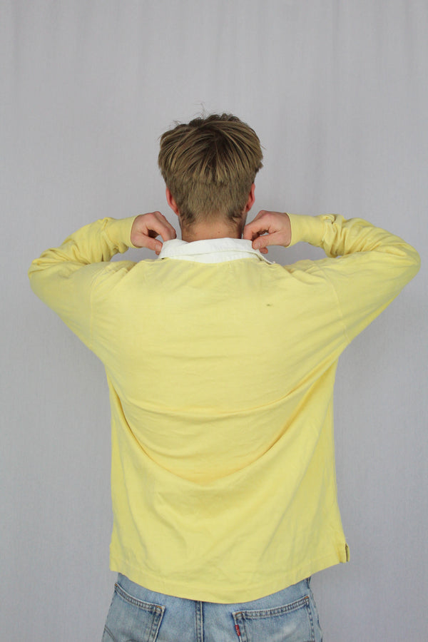 Pale yellow long sleeve polo