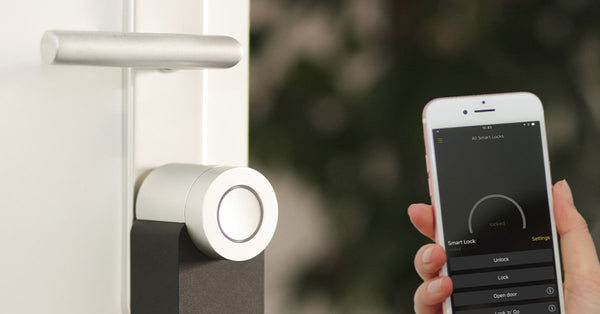 Smart lock for your home, phone being held next to a smart lock