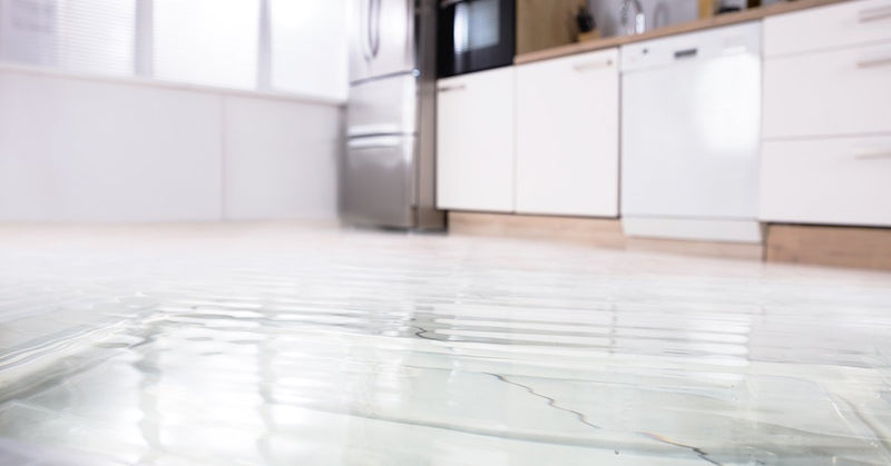Prevent Water Leaks: Water flooding the kitchen floor