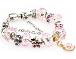 Pink Charm and Bead Bracelet with Flowers.